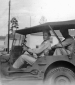814th Two guys in a jeep at Camp Polk Service Aug 1942
