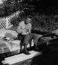 629th Shirtless soldier writing letter